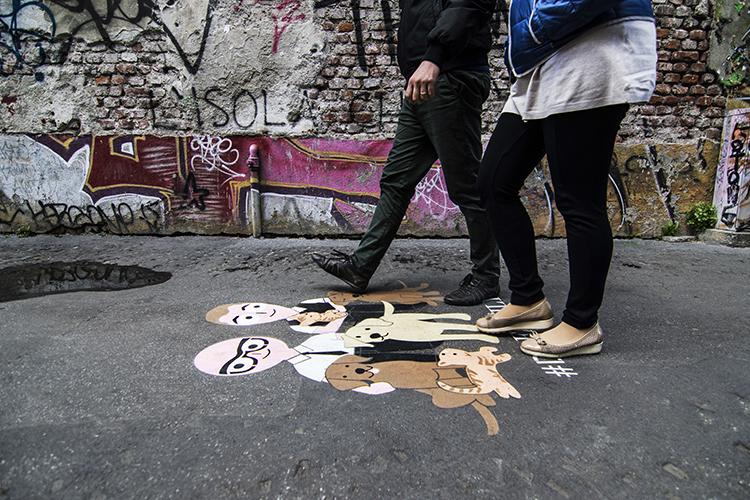 International street advertising Reverse Graffiti DGFamily Milano